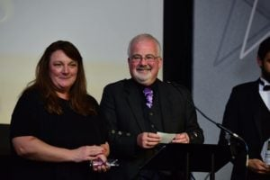 Sue and Angus present an award